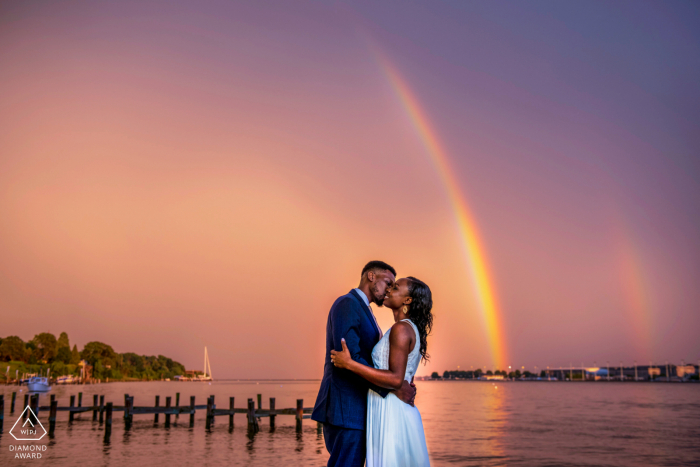 Annapolis, Maryland couple posing for engagement portraits Under double rainbows