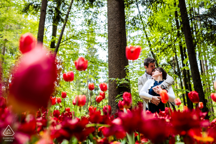 Ljubljana, Slovenia Poppies and hugs for a couple posing for engagement portraits