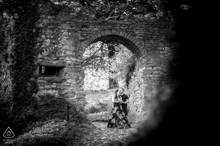 Ancient stonework couple engagement picture session at Château de Ferrette - France