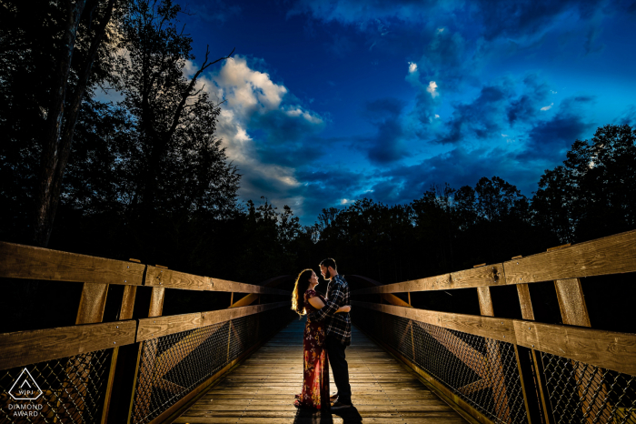 Wooden walkway engagement photos of a couple on bridge at dusk in Swatara State Park - Pine Grove, PA