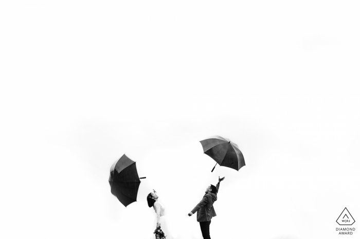 Black and white engagement shoot shoot with umbrellas in Sapa, Vietnam