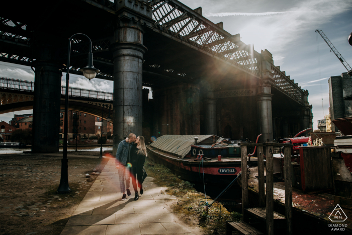 A Manchester, UK Couple kissing on a romantic walk during their engagement shoot
