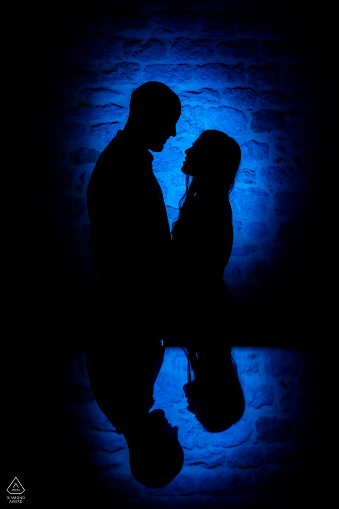 South of France Engagement portrait with a back light flash and iPad reflection at Castelnau de Montmiral