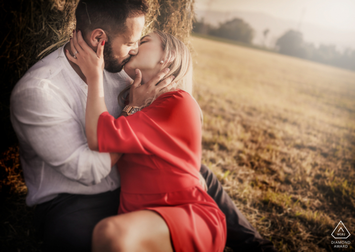 Schio Vicenza Italy Countryside Pre-Wedding Portrait of a couple sitting near a field with soft afternoon sunlight