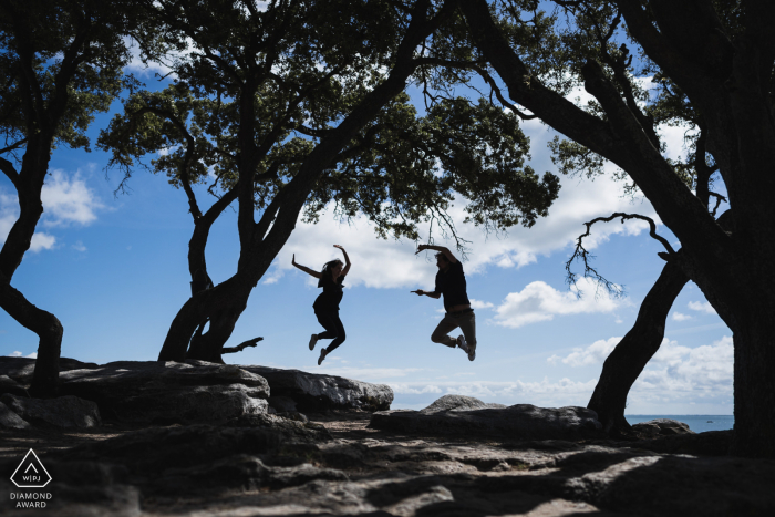 Noirmoutiers, France photography of the engaged couple jumping under the trees