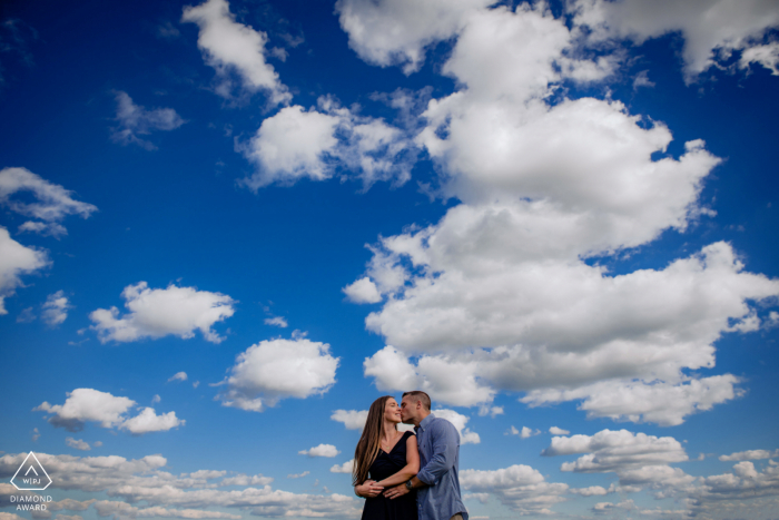 Maryland Engagement photography In the clouds with a centered couple embrace