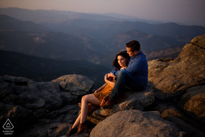 Colorado engagement photoshoot & pre-wedding session with A couple sharing a minute together at Lost Gulch Lookout in Boulder