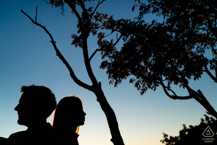 IT engagement portrait with a posed couple from Duino, Trieste, Italy showing off their Silhouettes
