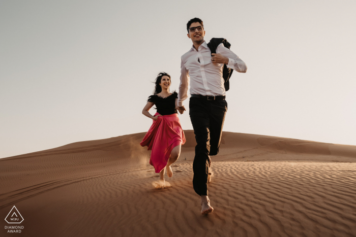 UAE sands engagement photo shoot with a fun loving couple in the Dubai Desert Having a laugh