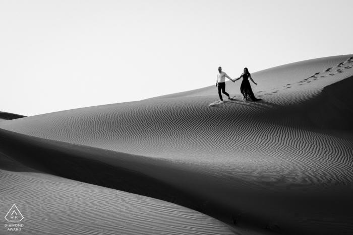 UAE desert pre-wedding photo session with an engaged couple from United Arab Emirates Exploring the Dubai desert