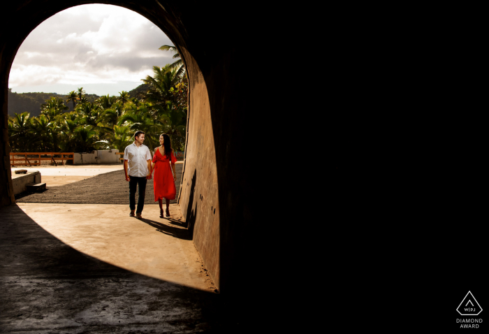 """Isabela, Puerto Rico Engagement photographer """"We saw how the light created a LOCATION ICON, so we added a light for subjects and created this."""" in Tunel Guajataca"""