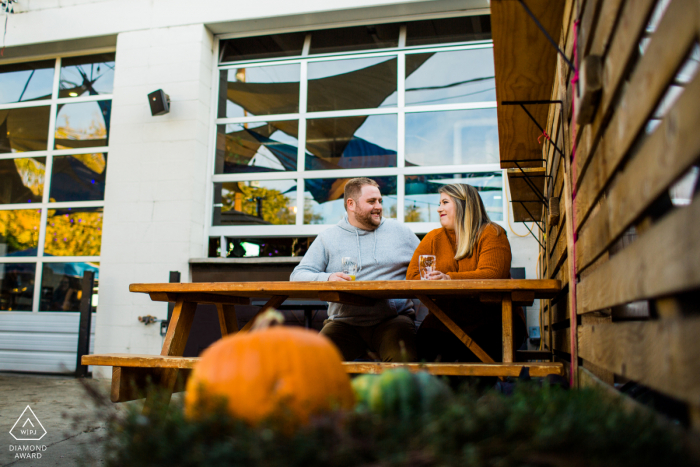 Zuni Street Brewing Couple hanging out on brewery's patio during a pre-wed photo shoot session