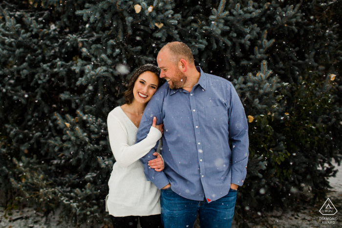 DeKoevend Park, Denver Couple posing in the snow during a pre-wed photography session