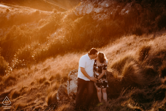 Port Hills Christchurch New Zealand Couple Kissing during an engagement photo session