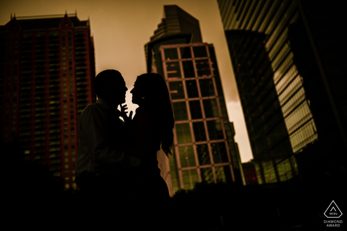 Houston, TX mini urban pic shoot before the wedding day with the Couple having a happy minute near Downtown