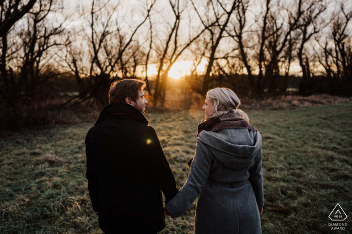 Mülheim an der Ruhr, Germany outside forest picture session before the wedding day while holding hands during the Sunrise