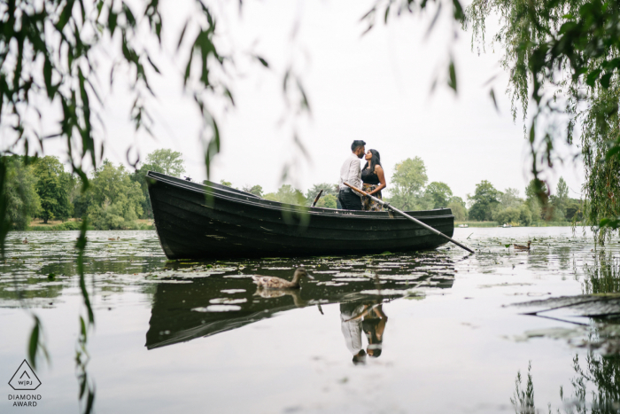 Hever Castle, England mini beach couple photography session before the wedding day kissing on a boat