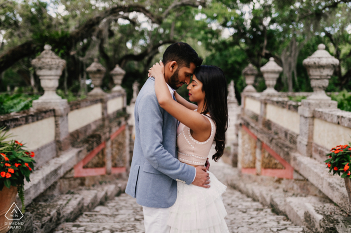 Vizcaya Miami, Florida pre wedding couple session while embracing in the outdoor park