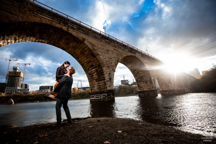 Stone Arch bridge couple portrait at the river in MN