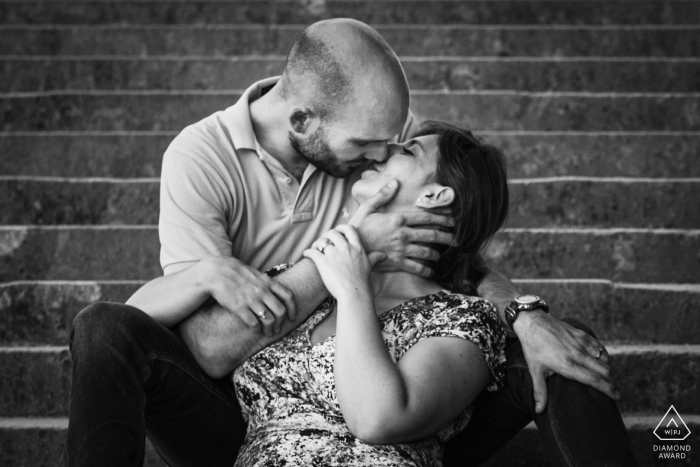 Paris couple portrait in black and white with some tender kissing on the stone steps