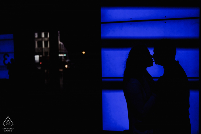 London, UK couple portrait with blue video screen backdrop