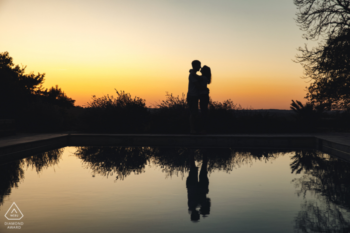 Chateau de Lartigolle, Gers sunset couple portrait as they hold each other in this silhouette