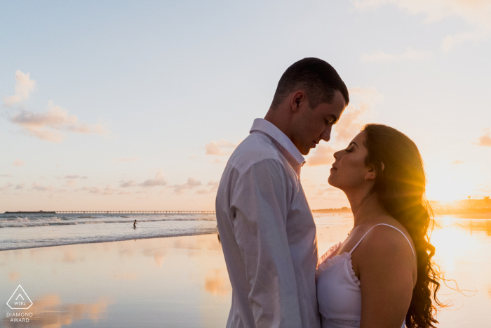 Maceió shoreline engagement photography of couple facing each other