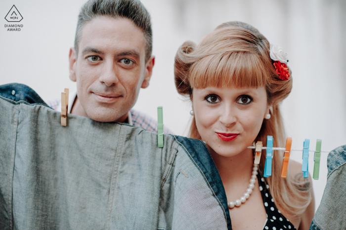 Bairro Alto, Lisboa couple portrait by a traditional Lisbon street with a clothes line and decided to pose to the picture