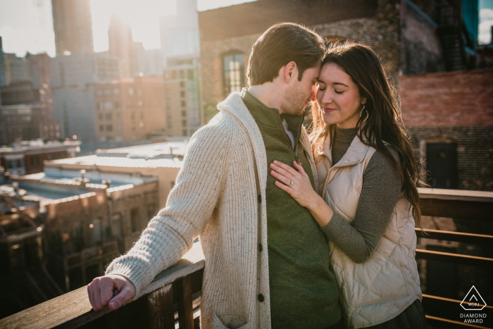 Chicago, IL pre wedding shoot of couple taking in the warm sun together on a Chicago rooftop