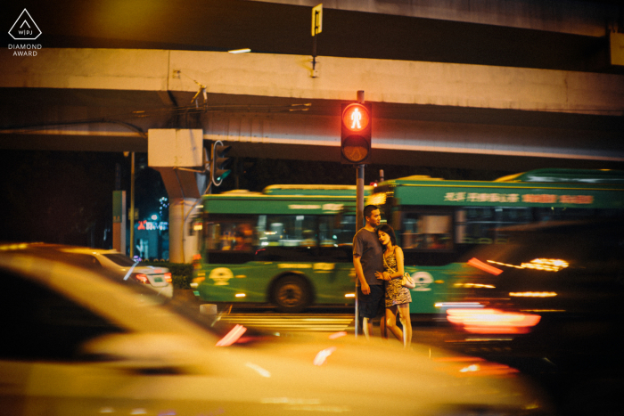 Guangzhou pre - wed image with some night life Embracing in the traffic under the lights