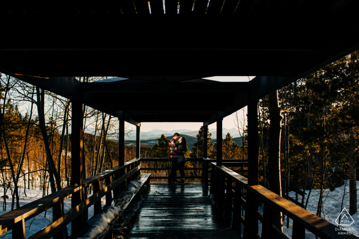 Colorado pre-wed portrait at Golden Gate Canyon State Park with the Couple standing in the deck/lookout area