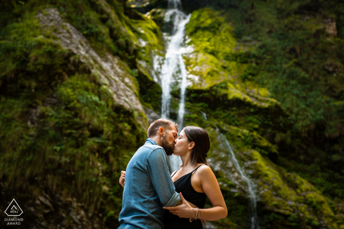 Friuli Venezia Giulia Fine Art Pre Wedding Portrait near A little waterfall surrounded by green mountains is a perfect scenario for this passionate kiss