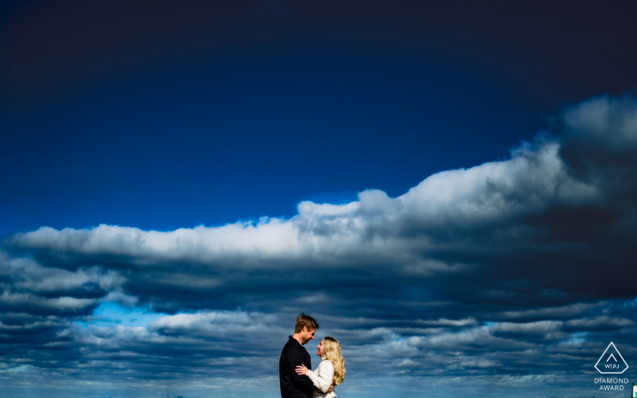 Toronto Pre Wedding Photoshoot in a Fine Art Style with some great Beach Vibes under the blue sky and clouds