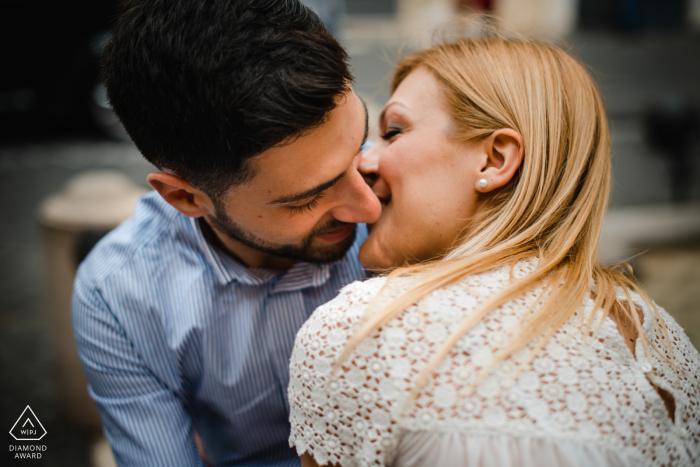 Trastevere Roma Fine Art Engagement Image showing the couple kissing