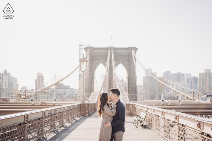 Brooklyn Bridge Fine Art Engagement Photos with a Kiss in the sunlight