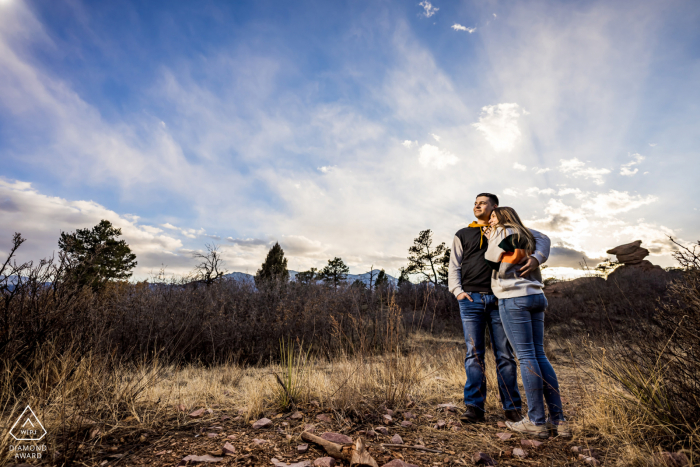 Garden of the Gods Fine Art Engagement Session in Colorado Springs created while the Couple enjoys the sunset