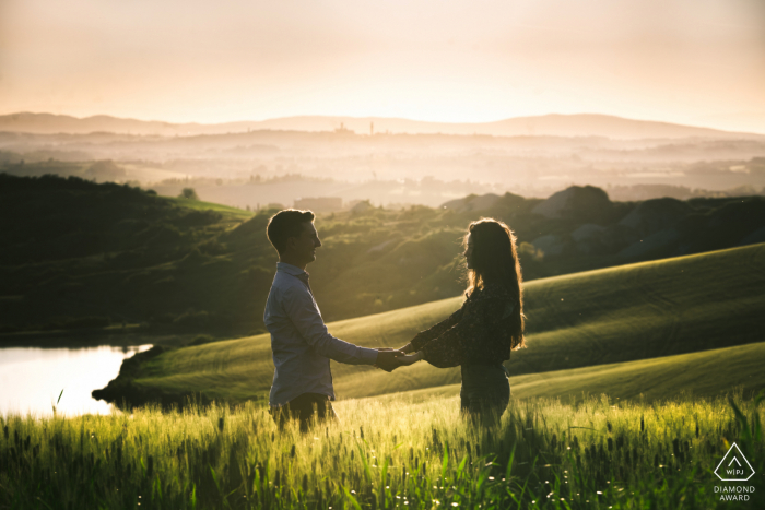 Crete Senesi, Siena portrait e-session of a couple holding hands with the hills and valleys as a backdrop