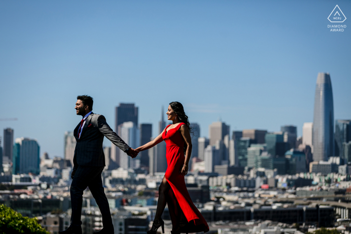 CA True Love pre wedding Photoshoot on Potrero Hill in San Francisco of a couple with a Lady in harsh red