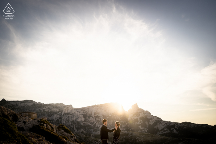 True Love Pre-Wedding Portrait Session in Marseille capturing a couple watching the sun rising behind them