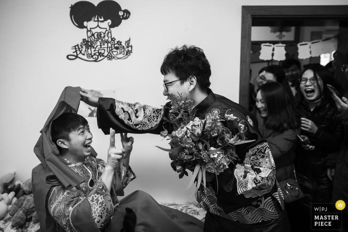 China bridal party having fun at the brides house before the wedding