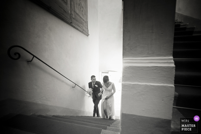 Ripalta Guerina, Italy bride and groom walk up the stairs