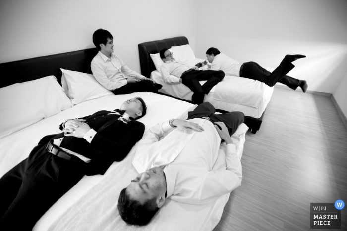 Malaysia groomsmen and groom laying on the beds before the wedding