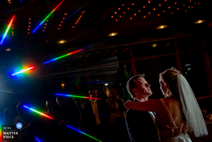 Oak brook, Illinois bride and groom dance with each other at the wedding reception