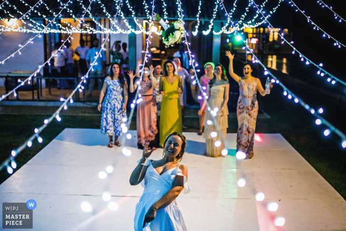 Guests getting ready to catch the bouquet at the reception at Frangipani Tree, Unawatuna, Sri Lanka
