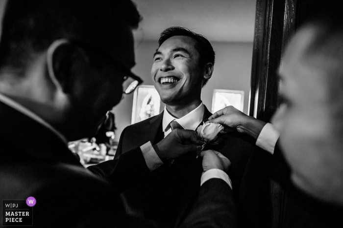 Groom getting ready with help at the St Robert's Catholic Church in San Bruno