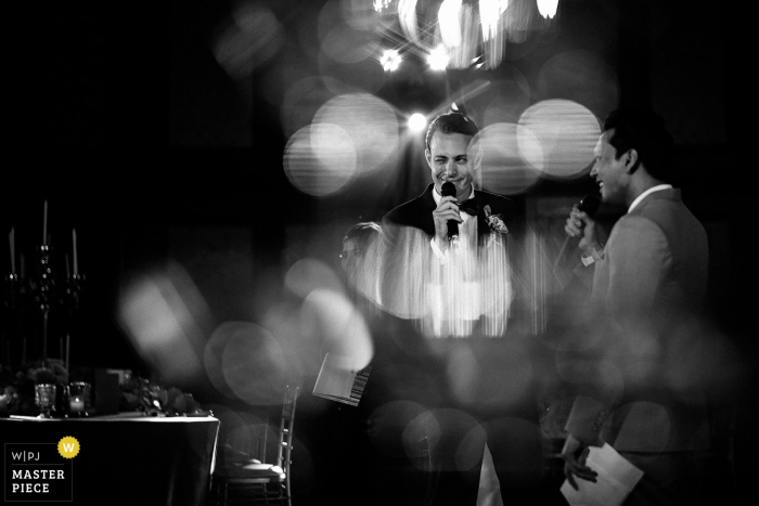 Bangkok, Thailand groom and best man speaking with black-and-white bokeh