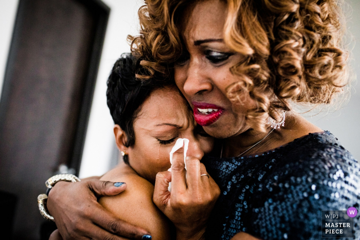 19 East Chicago Illinois Wedding Photo of Emotional Bride embraced and he Terfel of