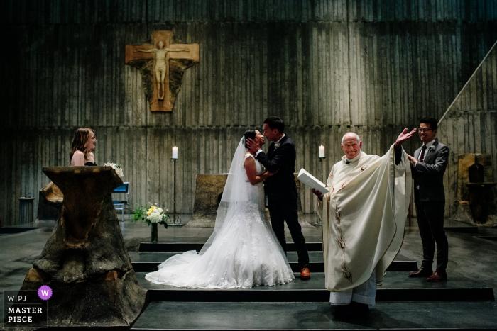 Berkeley, California bride and groom kiss at the wedding ceremony
