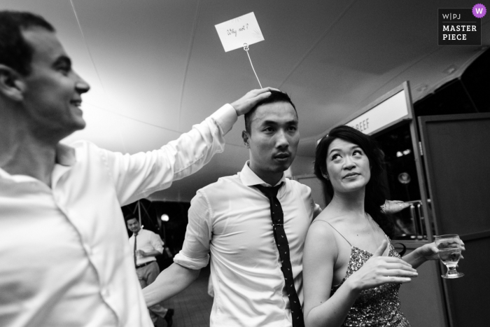 Guests joking around in a black-and-white photo from the wedding reception in San Francisco