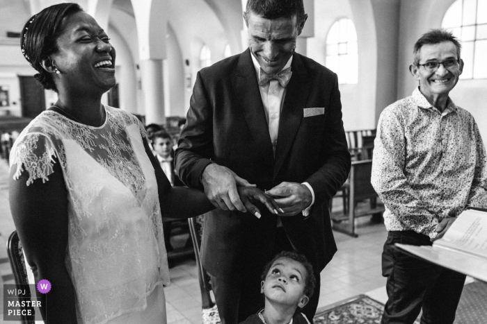 Candid photo of the ring ceremony inside a church in Montelimar